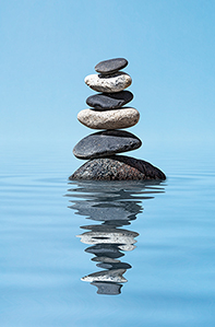 Stacked rocks with water ripples